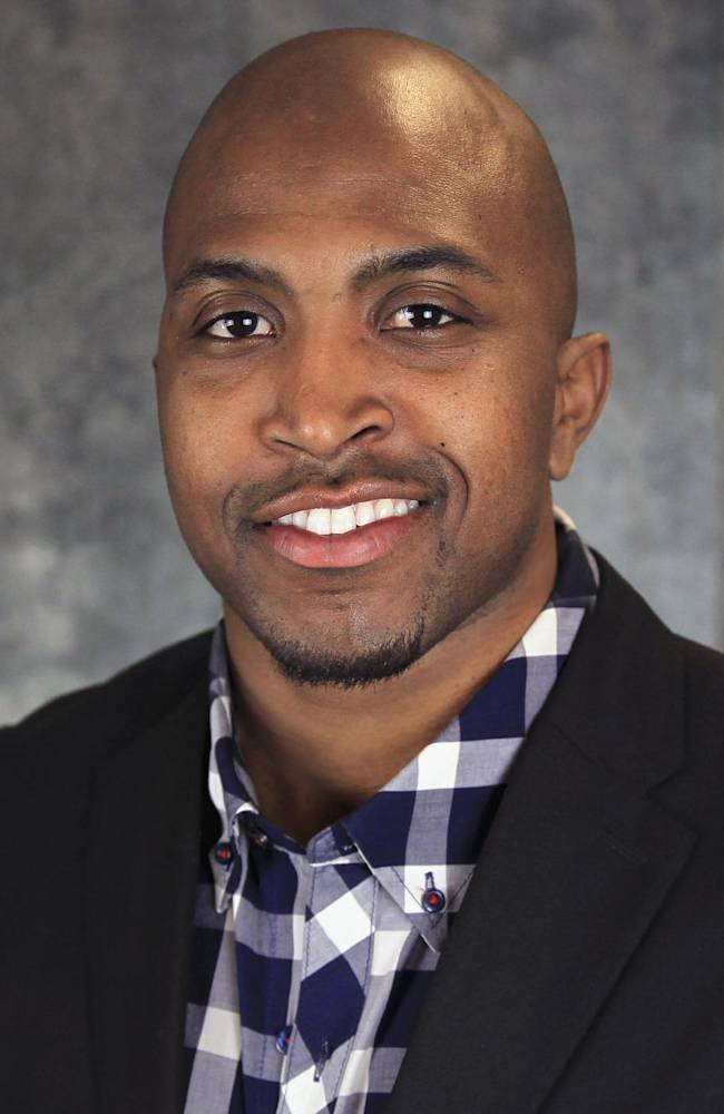 This undated photo provided by Minot State University shows Byron Thomas, who was named Tuesday, April 15, 2014, as the school's interim head football coach after newly hired coach Todd Hoffner decided to return to Minnesota State, Mankato. Thomas, who was the team's defensive coordinator, will assume the head coaching duties and lead the Beavers through the final two weeks of spring practice