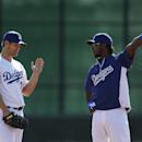 Los Angeles Dodgers pitcher Clayton Kershaw, left, and shortstop Hanley Ramirez talk during spring training baseball practice Thursday, Feb. 20, 2014, in Glendale, Ariz The Associated Press