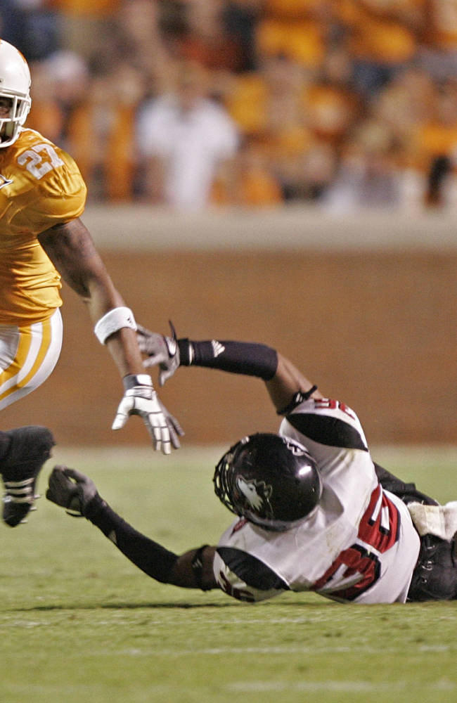 In this Oct. 4, 2008, file photo, Tennessee's Arian Foster (27) gets past Northern Illinois's Chase Carter (36) during the second half of an NCAA college football game in Knoxville, Tenn. Foster, now playing the NFL for the Houston Texans, says in an upcoming documentary he accepted money his senior year at Tennessee