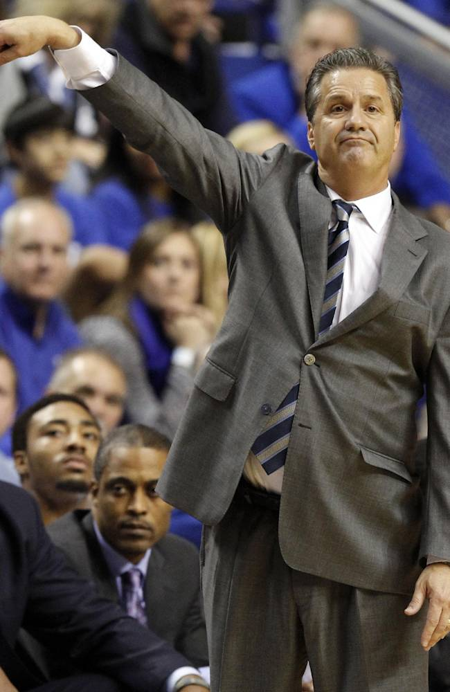 Kentucky head coach John Calipari directs his team during the first half of an NCAA college basketball game against Northern Kentucky, Sunday, Nov. 10, 2013, in Lexington, Ky