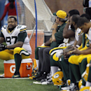Green Bay Packers defensive end Johnny Jolly (97) and teammates sit during the closing minutes of an NFL football game against the Detroit Lions in Detroit, Thursday, Nov. 28, 2013 The Associated Press