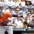 Houston Astros' J.D. Martinez loses his bat as he swings at a pitch in the first inning of the baseball game against the Pittsburgh Pirates on Sunday, May 19, 2013, in Pittsburgh. (AP Photo/Keith Srakocic)