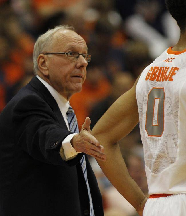 Syracuse's head coach Jim Boeheim talks with Michael Gbinije in the second half of an NCAA college basketball game against Colgate in Syracuse, N.Y., Saturday, Nov. 16, 2013. Syracuse won 69-50