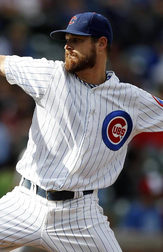 Chicago Cubs starting pitcher Travis Wood delivers against the Atlanta Braves during the first inning of a baseball game on Saturday, Sept. 21, 2013, in Chicago