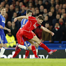 Liverpool's Steven Gerrard, right, attempts to shoot at goal during the English League Cup semifinal second leg soccer match between Chelsea and Liverpool at Stamford Bridge stadium in London, Tuesday, Jan. 27, 2015