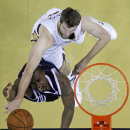 Oklahoma City Thunder forward Serge Ibaka, bottom, drives to the basket against New Orleans Pelicans center Jeff Withey in the second half of an NBA basketball game in New Orleans, Monday, April 14, 2014. The Pelicans won 101-89 The Associated Press