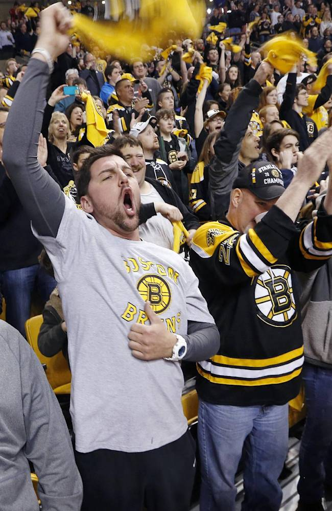Fans cheer at the start of Game 5 in the first round of the NHL hockey Stanley Cup playoffs   between the Boston Bruins and the Detroit Red Wings in Boston, Saturday, April 26, 2014