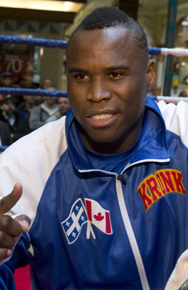 WBC light heavyweight champion Adonis Stevenson poses for a photo as he gets taped up for a public training session Tuesday, Nov. 26, 2013, in Quebec City. Stevenson will slated to defend his title against Tony Bellew of England,on Saturday in Quebec City