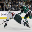 Minnesota Wild defenseman Jonas Brodin (25) defends on a shot by Dallas Stars center Tyler Seguin (91) iduirngthe first period of an NHL hockey game in Dallas on Saturday, March 8, 2014 The Associated Press