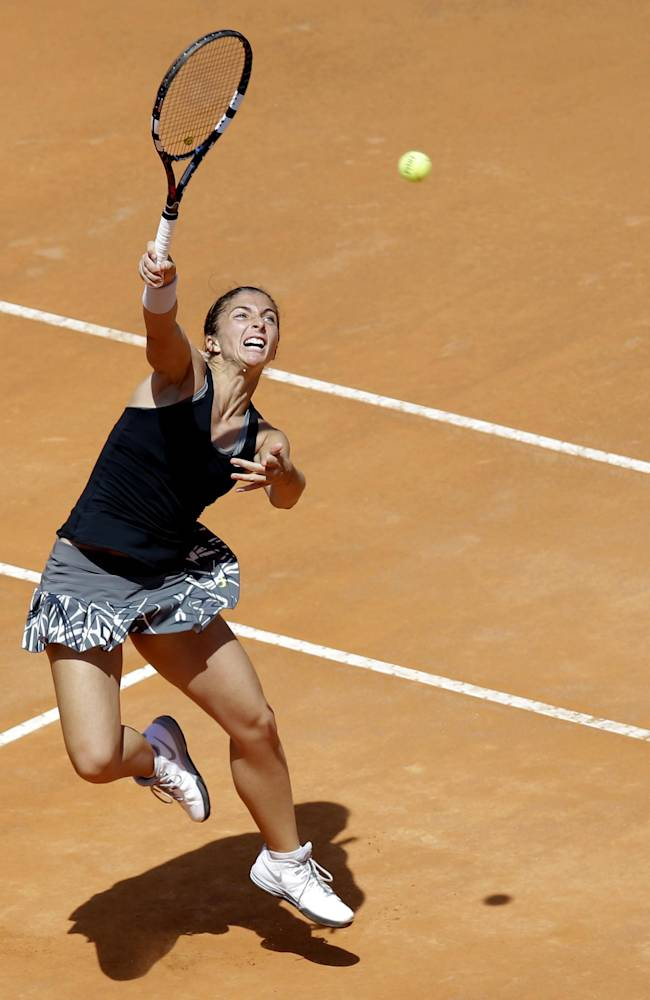 Italy's Sara Errani returns the ball to Serena Williams during their final match at the Italian Open tennis tournament, in Rome, Sunday, May 18, 2014. Serena Williams kept the crowd from being a factor in a 6-3, 6-0 victory over 10th-seeded Sara Errani to win the Italian Open for the third time Sunday