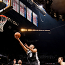 BROOKLYN, NY - FEBRUARY 10: Tony Parker #9 of the San Antonio Spurs shoots a layup against C.J. Watson #1 of the Brooklyn Nets on February 10, 2013 at the Barclays Center in the Brooklyn borough of New York City. (Photo by Nathaniel S. Butler/NBAE via Getty Images)