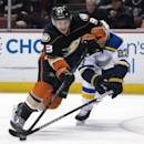 In this Sunday, Oct. 19, 2014, photo, Anaheim Ducks' Jakob Silfverberg, left, drives past the St. Louis Blues' Alex Pietrangelo  during an NHL hockey game in Anahein, Calif. (AP Photo/The Orange County Register, Kyusung Gong )