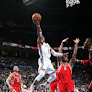 OKLAHOMA CITY, OK - MARCH 11: Russell Westbrook #0 of the Oklahoma City Thunder goes up for the layup against the Houston Rockets during an NBA game on March 11, 2014 at the Chesapeake Energy Arena in Oklahoma City, Oklahoma. (Photo by Layne Murdoch/NBAE via Getty Images)
