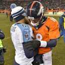 Denver Broncos quarterback Peyton Manning (18) and Tennessee Titans quarterback Ryan Fitzpatrick (4) talks following an NFL football game on Sunday, Dec. 8, 2013, in Denver The Associated Press