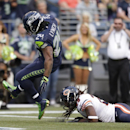 Seattle Seahawks' Marshawn Lynch (24) scores as Chicago Bears' Danny McCray hits the turf in the first half of a preseason NFL football game, Friday, Aug. 22, 2014, in Seattle The Associated Press