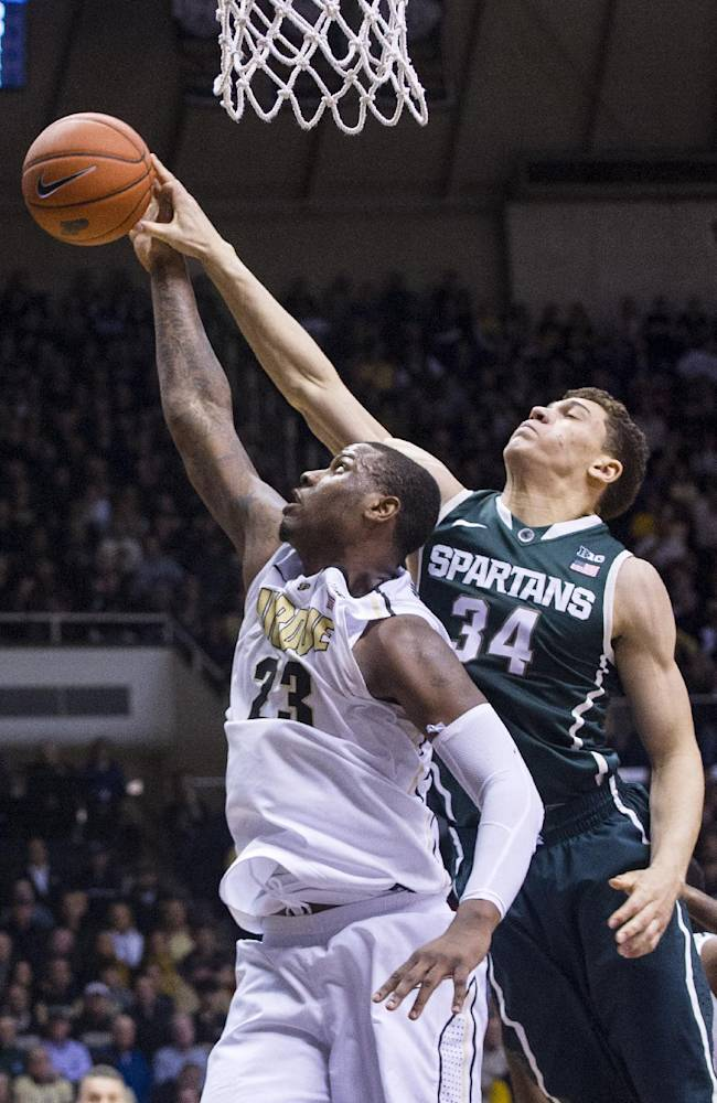 Purdue's Jay Simpson (23) and Michigan State's Gavin Schilling (34) go after a rebound in the first half of an NCAA college basketball game, Thursday, Feb. 20, 2014, in West Lafayette, Ind