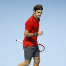 Switzerland's Roger Federer celebrates at match point after defeating Canada's Milos Raonic during their ATP World Tour Finals tennis match at the O2 Arena in London, Sunday, Nov. 9, 2014. (AP Photo/Kirsty Wigglesworth)