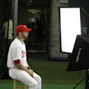 Philadelphia Phillies catcher Wil Nieves poses for a photographer during the team's photo day before a spring training baseball practice Wednesday, Feb. 19, 2014, in Clearwater, Fla The Associated Press