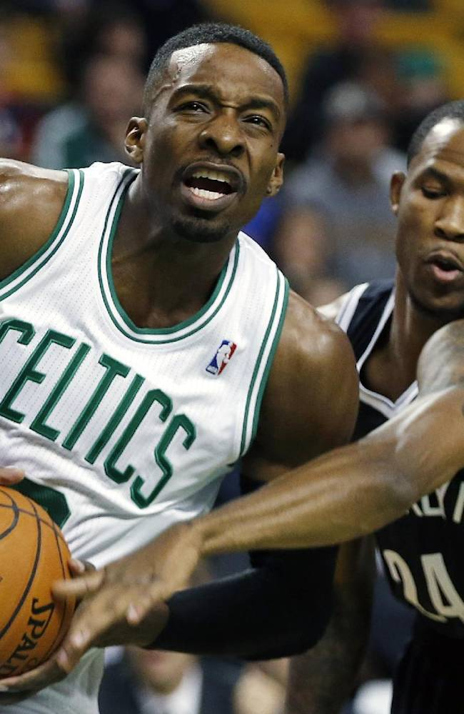 Boston Celtics' Jeff Green, left, drives for the basket past Brooklyn Nets' Chris Johnson (24) in the first quarter of a preseason NBA basketball game in Boston, Wednesday, Oct. 23, 2013