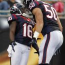 Houston Texans' Trindon Holliday (16) and  Bryan Braman (50) celebrate Holliday's touchdown against the Carolina Panthers during the first half of an NFL preseason football game in Charlotte, N.C., Saturday, Aug. 11, 2012. (AP Photo/Bob Leverone)