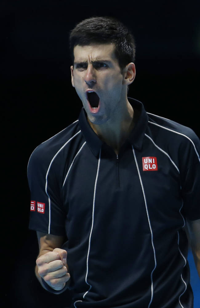 Novak Djokovic of Serbia cries out after a point win against Stanislas Wawrinka of Switzerland during their ATP World Tour Finals single semifinal tennis match at the O2 Arena in London Sunday, Nov. 10, 2013