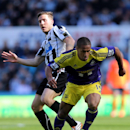 Swansea City's Wayne Routledge, right, vies for the ball with Newcastle United's Dan Gosling, left, during their English Premier League soccer match at St James' Park, Newcastle, England, Saturday, April 19, 2014