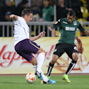 Krasnodar's Ricardo Laborde, right, fights for the ball with Everton's Phil Jagielka during the Europa League Group H soccer match between Krasnodar and Everton in Krasnodar, Russia, Thursday, Oct. 2, 2014