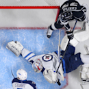 Winnipeg Jets goalie Michael Hutchinson, lower right, is scored on by Los Angeles Kings center Tyler Toffoli, as center Jeff Carter, upper left, looks on along with defenseman Mark Stuart during the first period of a NHL hockey game, Sunday, Oct. 12, 201