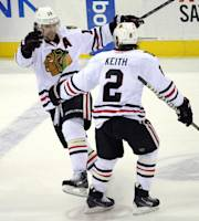 Chicago Blackhawks' Patrick Sharp celebrates his hat trick with Duncan Keith (2) during the third period of an NHL hockey game against the New Jersey Devils, Friday, Jan. 3, 2014, in Newark, N.J. The Blackhawks won 5-3. (AP Photo/Bill Kostroun)