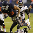 Chicago Bears running back Matt Forte (22) dives over Baltimore Ravens safety Matt Elam (26) during the second half of an NFL football game, Sunday, Nov. 17, 2013, in Chicago The Associated Press