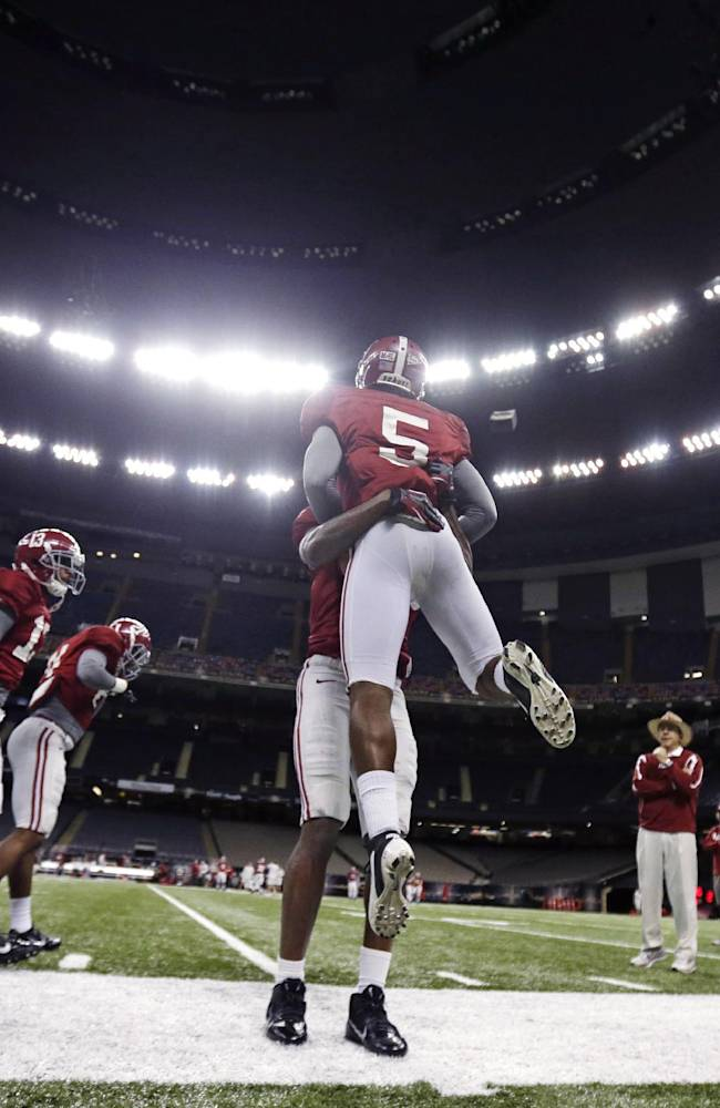 Alabama head coach Nick Saban, right, watches drillsduring NCAA college football practice at the Superdome in New Orleans, Saturday, Dec. 28, 2013.  Alabama takes on Oklahoma in the Sugar Bowl on Thursday, Jan. 2, 2014