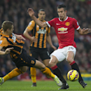 Robin van Persie, right, fights for the ball against Michael Dawson during the English Premier League soccer match between Manchester United and Hull City at Old Trafford Stadium, Manchester, England, Saturday Nov. 29, 2014