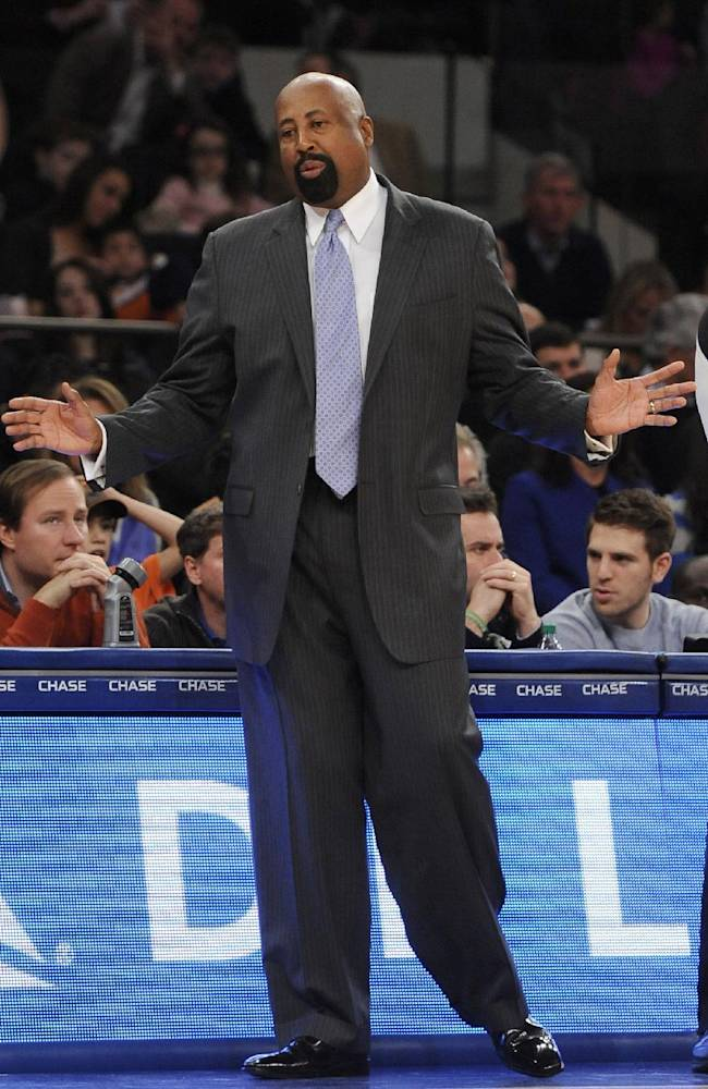 In this Dec. 8, 2013 file photo, New York Knicks head coach Mike Woodson reacts to his team during an NBA basketball game against the Boston Celtics, in New York. The Knicks have fired Woodson after falling from division champions to out of the playoffs in one season. New team president Phil Jackson made the decision Monday, April 21, 2014, saying in a statement