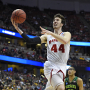 FILE - In this March 27, 2014, file photo, Wisconsin forward Frank Kaminsky (44) drives as Baylor center Isaiah Austin (21) watches during the second half in a regional semifinal NCAA college basketball tournament game in Anaheim, Calif. Wisconsin is the unanimous pick to win the Big Ten, and the Badgers' Kaminsky is the Preseason Player of the Year. (AP Photo/Mark J. Terrill, File)