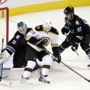 San Jose Sharks goalie Antti Niemi (31), of Finland, deflects a shot next to Boston Bruins center Carl Soderberg (34), of Sweden, and Sharks' Scott Hannan (27) during the first period of an NHL hockey game Thursday, Dec. 4, 2014, in San Jose, Calif The As