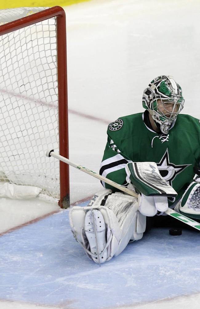 Dallas Stars goalie Kari Lehtonen (32) sits after Anaheim Ducks Nick Bonino scored the game winning overtime goal of Game 6 to win the first-round NHL hockey playoff series in Dallas, Sunday, April 27, 2014