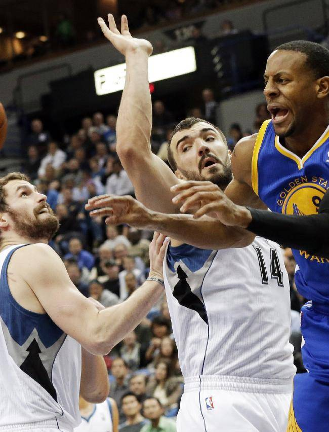Golden State Warriors' Andre Iguodala, right, gets off a pass as Minnesota Timberwolves' Kevin Love, left, and Nikola Pekovic, center, of Montenegro, defend in the second half of an NBA basketball game Wednesday, Nov. 6, 2013, in Minneapolis. The Warriors won 106-93