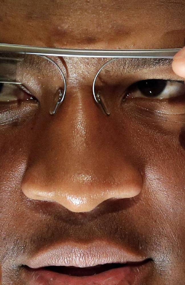 Florida State's Jameis Winston ttys out some Google glasses during media day for the NCAA BCS National Championship college football game Saturday, Jan. 4, 2014, in Newport Beach, Calif. Florida State plays Auburn on Monday, Jan. 6, 2014
