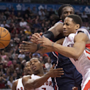 Toronto Raptors forward DeMar DeRozan, right, is fouled by Atlanta Hawks forward DeMarre Carroll, back, during the second half of an NBA basketball game in Toronto on Sunday, March 23, 2014 The Associated Press