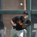 San Francisco Giants right fielder Hunter Pence makes the catch for the out on Arizona Diamondbacks' Martin Prado during the first inning of a spring training baseball game Sunday, March 2, 2014, in Scottsdale, Ariz The Associated Press