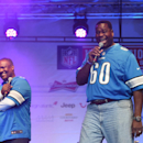 Former Detroit Lions players Bubba Baker, right, and Rodney Peete speak to fans on stage during the NFL Fan Rally in Trafalgar Square, London, England, Saturday, Oct. 25, 2014. The Atlanta Falcons will play the Detroit Lions in an NFL football game at Lon