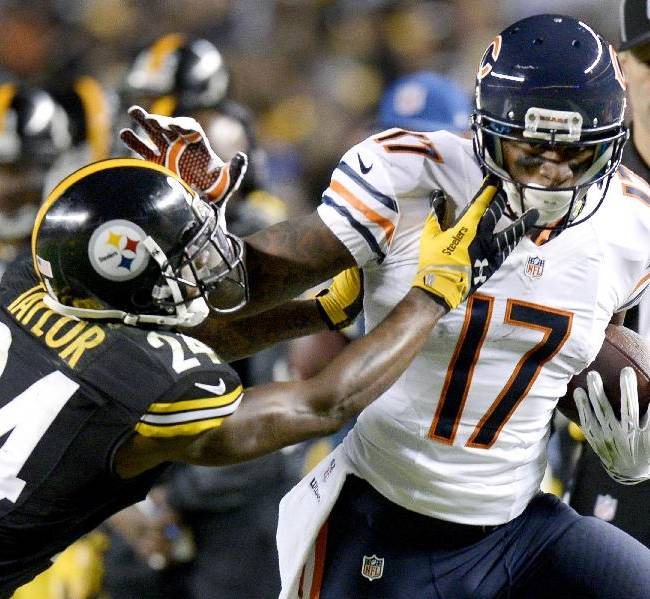 Chicago Bears wide receiver Alshon Jeffery (17) is hit by Pittsburgh Steelers cornerback Ike Taylor (24) after making a catch in the third quarter of an NFL football game on Sunday, Sept. 22, 2013, in Pittsburgh
