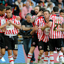 Sheffield United's players celebrate after Jose Baxter, second left, scored against Hull City during the English FA Cup semifinal soccer match between Hull City and Sheffield United at Wembley Stadium, London, England, Sunday, April 13, 2014