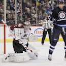 Winnipeg Jets' Blake Wheeler (26) attempts to deflect the shot past Colorado Avalanche's goaltender Semyon Varlamov (1) during second period NHL action in Winnipeg, Manitoba, on Thursday, Dec. 12, 2013 The Associated Press