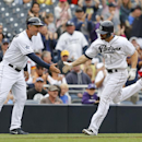 San Diego Padres' Xavier Nady is congratulated by third base coach Glenn Hoffman while rounding the bases on a solo home run against the Colorado Rockies during the fourth inning of a baseball game Thursday, April 17, 2014, in San Diego The Associated Pre