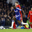 Liverpool's Steven Gerrard, rear, battles for the ball with Chelsea's Ramires during the English League Cup semifinal second leg soccer match between Chelsea and Liverpool at Stamford Bridge stadium in London, Tuesday, Jan. 27, 2015