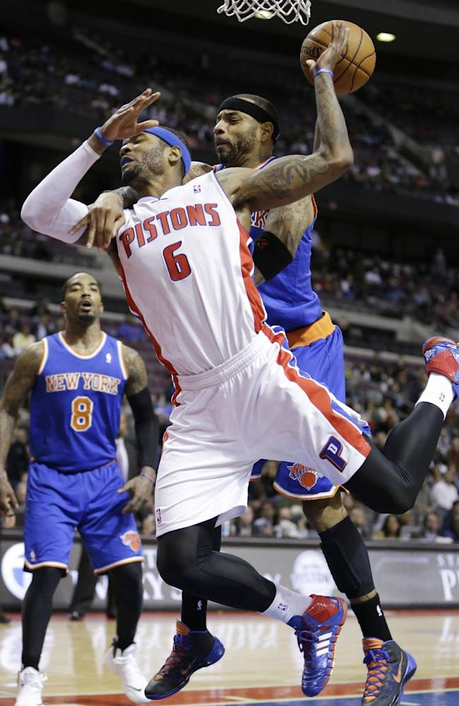 Detroit Pistons forward Josh Smith (6) is fouled by New York Knicks forward Kenyon Martin (3) during the second half of an NBA basketball game in Auburn Hills, Mich., Tuesday, Nov. 19, 2013