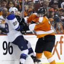 Philadelphia Flyers' Luke Schenn, right, collides with St. Louis Blues' Steve Ott during the second period of an NHL hockey game, Saturday, March 22, 2014, in Philadelphia The Associated Press