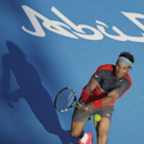 Rafael Nadal of Spain returns the ball to Jo-Wilfried Tsonga of France during a match for third place of the Mubadala World Tennis Championship in Abu Dhabi, United Arab Emirates, Saturday, Dec. 28, 2013. (AP Photo/Kamran Jebreili)