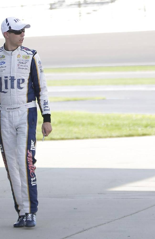 Driver Brad Keselowski walks to his garage before practice for the Brickyard 400 Sprint Cup series auto race at the Indianapolis Motor Speedway in Indianapolis, Saturday, July 26, 2014